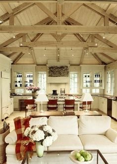 love rustic wooden beams, the openness of kitchen to living room and comforting colors