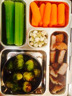 Roasted Brussels sprouts, seared pork chop, carrots, celery, and wasabi pea treat. Paleo lunch. Groves Planet Box