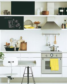 Black and white is a classic combo and the pops of yellow, wood and stainless steel provide just enough interest to make this kitchen feel fresh and organized without being too minimal.
