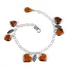 This 8 long bracelet features genuine Russian amber hearts and etched sterling silver leaves dangling from a chain. The pretty bracelet can adjust size depending on where you clasp it, but generally fits wrists around in size. Crafted in Russia. Amber Heart, Sterling Silver Bead Bracelet, Amber Jewelry, Dangles, Beaded Bracelets, Chain, Russia, Hearts, Pretty