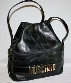 http://www.etsy.com/listing/101999118/vintage-moschino-hobo-black-leather?ref=usr_faveitems_uid=21720629