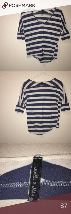 Molli & Mia Blue and White Striped Shirt This casual shirt works in any season, making it a closet must have! The shirt is slightly longer in the back making it a fantastic combination with leggings or even jeans! Layer with a necklace to give this shirt the sparkle it needs Molli & Mia Tops Tees - Short Sleeve