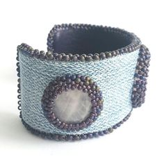 Leather cuff bracelet, denim bracelet, jeans bracelet, cabochon bracelet, handmade jewelry, with 3 pink quarts cabochons.