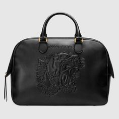 d0fc40db651 Embossed leather duffle Gucci Purses
