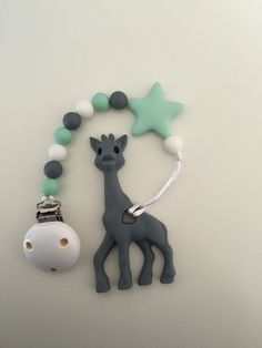 Silicone/wood teething Pendant, Giraffe toy by Babyshop247 on Etsy https://www.etsy.com/ca/listing/469960740/siliconewood-teething-pendant-giraffe