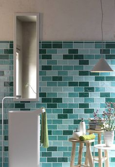 Mixed brick tiles in turquoise, aqua, and deep green give a maritime feel to the space. Bathroom Showrooms, Bathroom Interior, Bathroom Ideas, Bathrooms, Bathroom Design Inspiration, Interior Inspiration, Wall And Floor Tiles, Wall Tiles, Brick Tiles