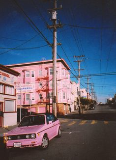 Pink Car and Apartment Building