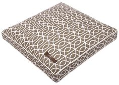 Ferla    A gate inspired white pattern set atop a dark taupe backdrop.