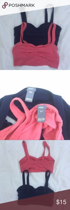 """TWO Aerie Sleep Bras!! Probably the comfiest bras you will ever buy . Meant to be a """"sleep bra"""", meaning it's soft and it doesn't even feel like you're wearing a bra! Two colors, pink & navy. The pink is small and the navy is medium, however the sizes seem somewhat interchangeable to me considering I didn't even realize they were different. LOVE these, & you will too!! Great condition for both.  aerie Intimates & Sleepwear Bras"""