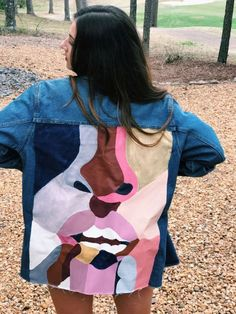 Hand painted upcycled denim jacket.