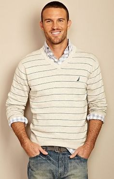 {This is a really easy look that not only seems to be effortless, like there was no thought behind it, but it incorporates 2 patterns (the horizontal lines of the v-neck with the pattern on the button-down underneath it), but stays simple and masculine.}