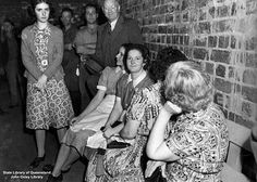 Scene of women sitting in a Brisbane air raid shelter during a test alarm during World War Two. (Description supplied with the photograph.)