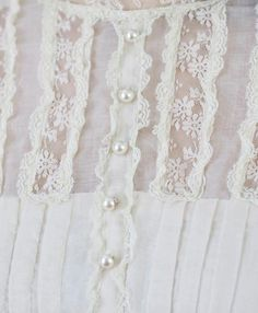 pearl button pin pleated lace blouse
