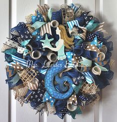 A personal favorite from my Etsy shop https://www.etsy.com/listing/286277303/mermaid-deco-mesh-wreath-beach-wreath