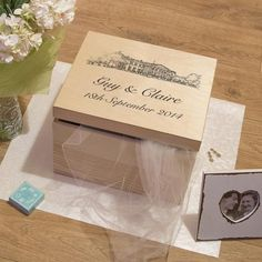 Wooden personalised keepsake box with an illustration of your wedding venue, the perfect personalised wedding gift.