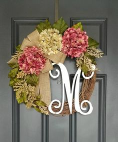 Plum Hydrangea Wreath , Grapevine Wreath , Spring Wreath The wreath offers a traditional design that sets the tone for the year round. Natural grapevine and artificial Hydrangeas ornate with extra leaves and cream/vintage spray to give a Farmhouse / Rustic look . Attached triple