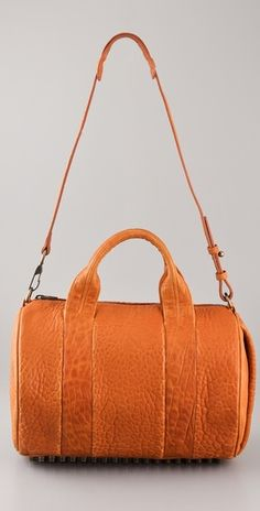 Rocco Duffel in Tangerine? So many studs. How to get *this* through airport security. Sigh.