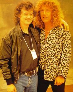 Jimmy Page and Robert Plant...this shot in gold tint. The best of mates....