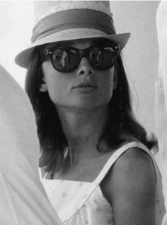 Audrey Hepburn in a hat & glasses