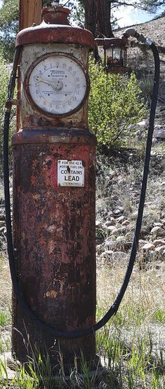 old gas pump Notice the contains lead sign.  Once lead paint was banned, every country on Earth experienced a significantly decreased crime rate exactly one generation later