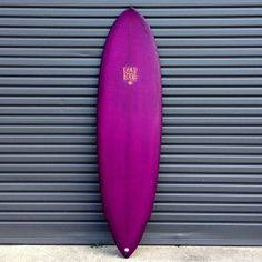 6'3 Hellhound. Killer berry colour way and a dirty white plug in the rear.