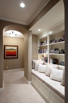 Hallway Library...clever idea to use space and make it functional:) Definitely pleasing to the eye.