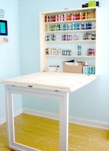 craft room desk Great idea love the hidden table that folds up.Would use a full length cabinet