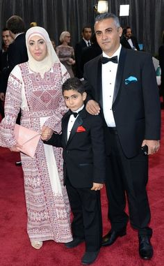 """The director of """"5 Broken Cameras,"""" Emad Burnat, his wife Soraya Burnat, and their son at the Oscar's Yesterday. The movie was nominated for Best Documentary Feature, it didn't win but seeing them get that far made us Palestinians everywhere so proud.  http://www.facebook.com/photo.php?fbid=530032413703170=a.268670593172688.67195.264190880287326=1"""