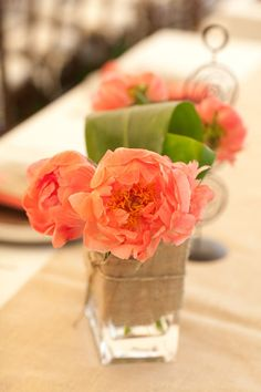coral flowers, and I like the burlap wrapped around the vase. I was thinking about doing that or even wrapping lace around the jars.