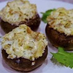 These delicious appetizer mushrooms are stuffed with chopped crabmeat, lobster, garlic, and seasoned croutons, then topped with mozzarella and baked.