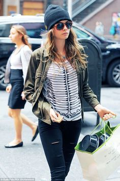 Messy hair, don't care: She looked perfectly relaxed as she went about her day, her dark b...