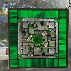 Green and pink stained glass window hanging