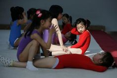 Shanghai, China. Girls practice sit-ups during a gymnastics lesson at the youth amateur athletic school. China's sports system has been enormously successful since the country returned to the Olympic fold in 1980, culminating with the host nation topping the medals' table at the 2008 Beijing Olympics. And yet, with the Rio de Janeiro Games less than three months away, the system is beginning to break down due to the shifting demographics of a more prosperous nation.