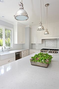 Silestone Lagoon is from the Nebula Series. It has a unique aesthetic that creates movement through veining adding depth to any kitchen. These white cabinets and cup pulls are similar to ours and I like the overhead lights Custom Kitchen Cabinets, Kitchen Cabinet Design, Kitchen Redo, New Kitchen, Kitchen Remodel, Kitchen Dining, Kitchen Ideas, Kitchen Planning, Green Kitchen