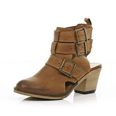 Brown cut out back biker boots $120.00 though you could probably find cheap knock offs exactly the same.