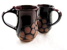 ceramic mugs with interesting carving - love the contrast between glaze and un-glazed clay