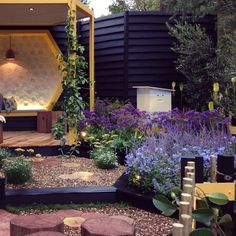 Porter's Paints was proud to support the talented (and Silver Medal winning garden!!) @jennysmithgardens at the 2015 Melbourne International Flower and Garden Show! This was a special space that told the story of the bee keeper and a fitting tribute to the garden of Jenny's childhood, a lilac filled country garden created by her mother Bee. If only we could have captured the atmosphere and whimsy at every turn.The beautiful scene here seen bouncing off Palm Beach Black