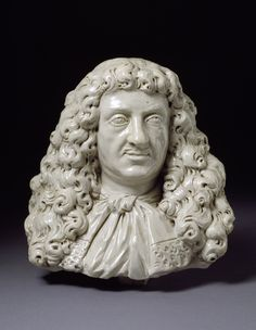 """Stoneware bust of John Dwight, circa 1673-75. """"Possibly the earliest portrait bust to be modelled in salt-glazed stoneware anywhere in Europe, this bust was clearly modelled by an accomplished (but still unknown) sculptor familiar with working in terracotta or wax. As the founder of the Fulham Pottery, John Dwight had high hopes for his patented material and, like Josiah Wedgwood in the 18th century, intended that his humble pottery should become associated with the fine arts, and perhaps…"""