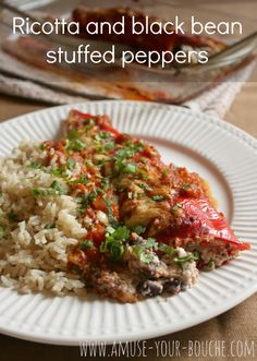 Ricotta and black bean stuffed peppers - not your average stuffed peppers! The creamy ricotta filling cuts through the rich tomato sauce perfectly. Use one of Aldi's three packs of multi-colored peppers to make more budget friendly. Vegetarian Main Dishes, Vegetarian Dinners, Vegetarian Recipes Easy, Vegetable Recipes, Cooking Recipes, Healthy Recipes, Budget Cooking, Clean Eating, Healthy Eating