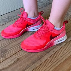 sports shoes 46133 64b2f Shop Women s Nike Pink Red size Sneakers at a discounted price at Poshmark.  Description  Minimally worn Nike Air Max Thea in great condition!