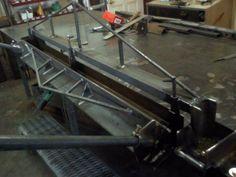 Sheetmetal Brake by app ironworksllc -- Homemade sheetmetal brake fabricated from angle iron, tubing, and steel rod. Capable of bending 16 gauge sheetmetal. Maximum bending angle is 96 degrees. http://www.homemadetools.net/homemade-sheetmetal-brake-49