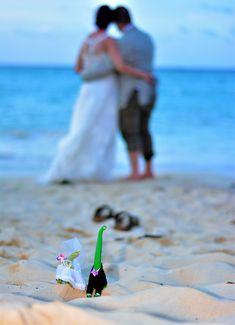 Best dinosaur cake toppers ever!  #dinosaurwedding #dinosaurcaketopper #uniqueweddingcaketopper #weddingcaketopper