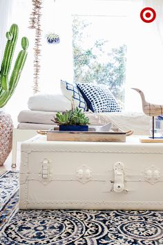 vintage trunk-turned-coffee table--cover it with a healthy coat of white paint. Once dry, trays are a great way to keep the surface both stylish and organized. Top off the tray with a few natural accents and plants, limiting it to 3 items to avoid clutter.