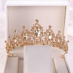 Buy Gold Crystal Quinceañera Tiara and other quinceanera products on Mi Padrino for quinceaneras, tres años, weddings, baby showers, and other events in the Hispanic community. Charro Quinceanera Dresses, Quinceanera Tiaras, Quinceanera Party, Prom Party, Prom Dresses, Bridal Crown, Bridal Tiara, Mary's Bridal, Baby Tiara