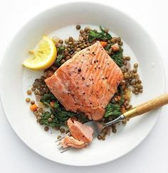 Recipe: Wild Salmon with Lentils and Arugula . I substituted spinach for the arugula, and I used french green lentils -- all of the flavors go nicely -- savory and fresh! Arugula Recipes, Salmon Recipes, Fish Recipes, Seafood Recipes, Cooking Recipes, Clean Eating, Healthy Eating, Healthy Food, Eating Well