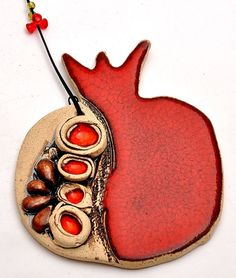 Red Pomegranate Ceramics Enamel Painting Special handmade ceramics by Siegel and Marcy arts       Dimensions     11cm height x 9cm width    Siegel and Marcy arts work together to form Hamsa clocks and spectacular special plates BUTIFUL work. Their work is characterized by motifs from Judaism and Judaica Star of David, a grenade, Hamsa, life. Each item Ceramic arts are investing in their work from any work Ihiodit unique design every item was born at the end of the piece in its own unique…