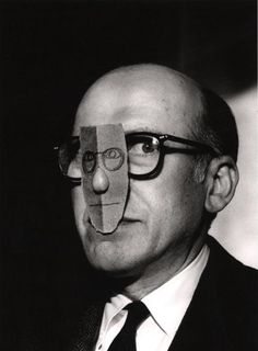 Saul Steinberg wearing a nose mask of his own face. From the Mask Series with Saul Steinberg, Photograph by Inge Morath © The Inge Morath Foundation/MAGNUM PHOTOS. Saul Steinberg, The New Yorker, Inge Morath, Rebecca Miller, Jean Arp, Photo Portrait, Photographer Portfolio, Magnum Photos, Art Plastique