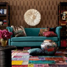 one of my favorites from houzz.com. Teal Couch. Colorful rug. eclectic living room decor.