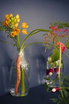 flower and vegetable arrangement by Sania Pell, author of Homemade Home for Children, on Remodelista via the improvised life (photo by Rahel Weiss)