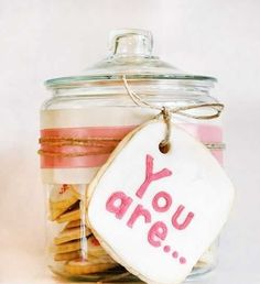 A Mother's Day cookie jar filled with cookies that describe them, do it for a best friend too!